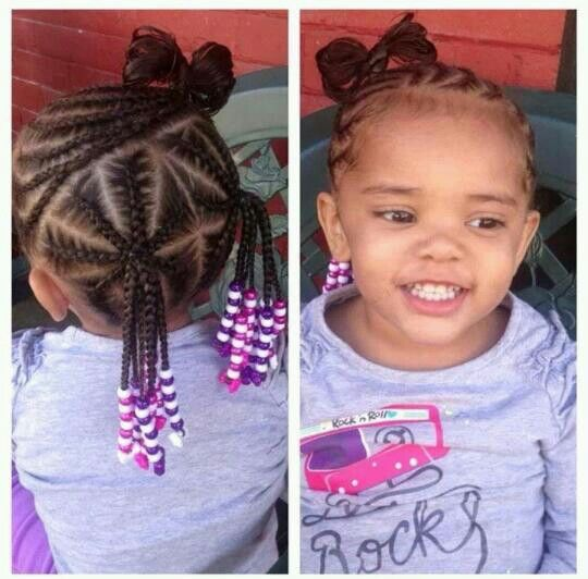Girl hair cornrowed into ponytails and bow #beads #cornrow #ponytail #braids