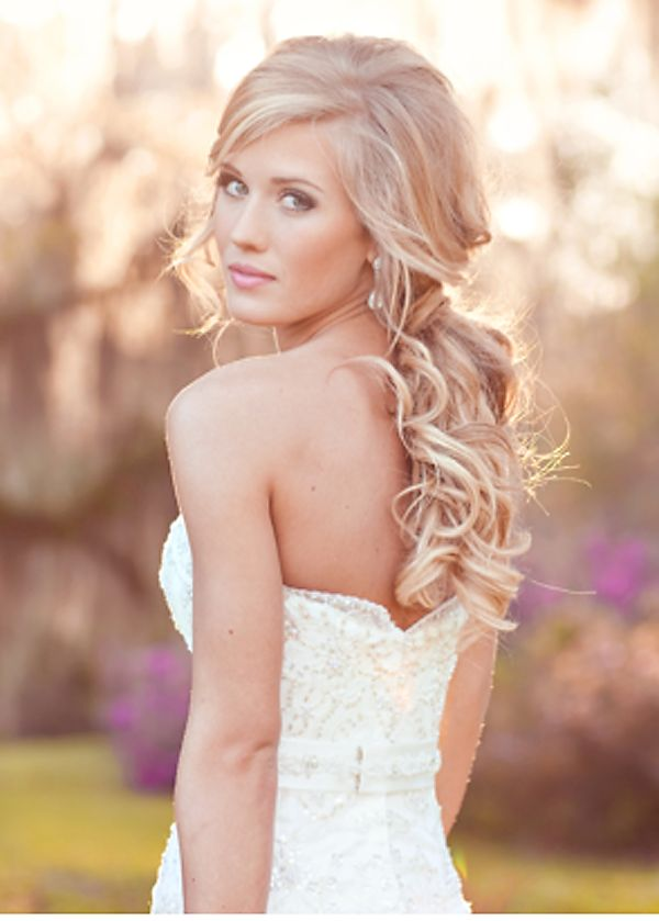 Pretty #wedding hairdo. Do you know yet if you'll be wearing your hair up or like this at your wedding?