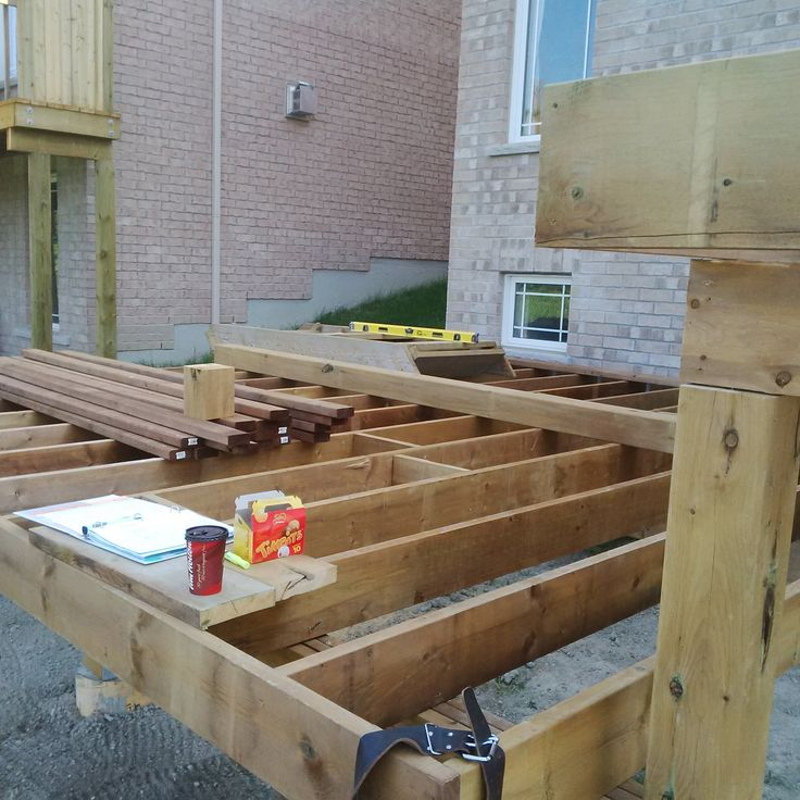 joists and posts build with brown pressure treated lumber.