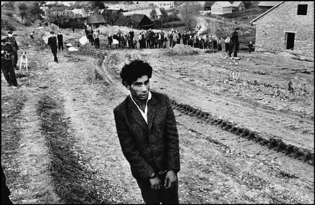 """CZECHOSLOVAKIA. 1963. Slovakia. Jarabina. Reconstruction of a homicide. © Josef Koudelka / Magnum Photos """"...I can see that a certain type of photography has come to an end because the subjects don't exist anymore. From 1961 to 1966 I took pictures of Gypsies because I loved the music and culture. They were like me in many ways. Now there are less and less of these people so I can't really say anything else about them."""" Josef Koudelka"""