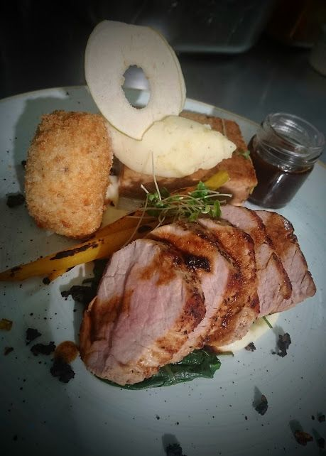 Pork fillet and braised belly, kale, spring onion and mustard croquette, baby carrot and caraway jus.