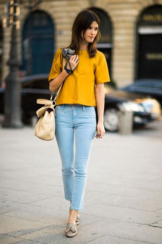 Blogger Photographer Hanneli Mustaparta. Jeans by MiH, Ralph Lauren bag, and Burberry shoes.