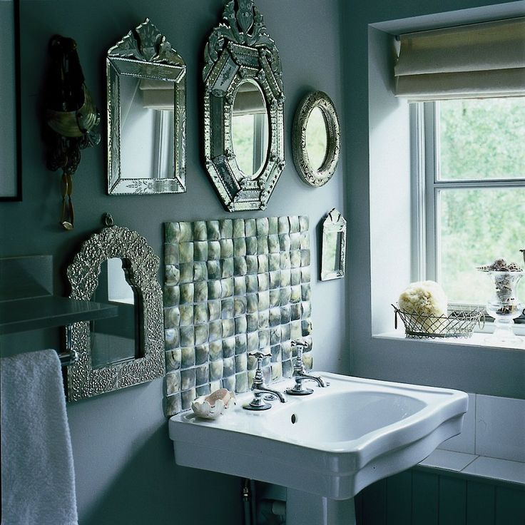 Grey mother of pearl tiles as splash-back. This is a cool idea on a budget, love the vintage mirrors
