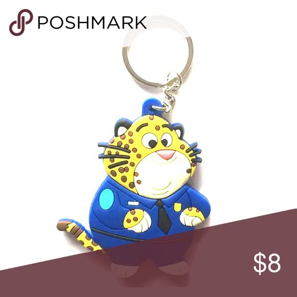 Police Cat Keychain New without tags. Cat dresses as a police officer. Cute accessory to add to keys or purse. Accessories Key & Card Holders