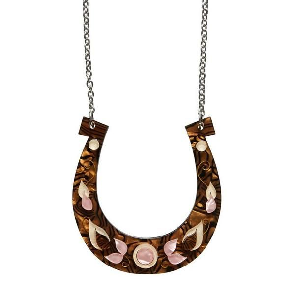 """Erstwilder Collectible Lucks a Fortune Necklace. """"And not just in the Old West either. Egyptian iconography and Islamic art both consider the horseshoe a good omen."""""""