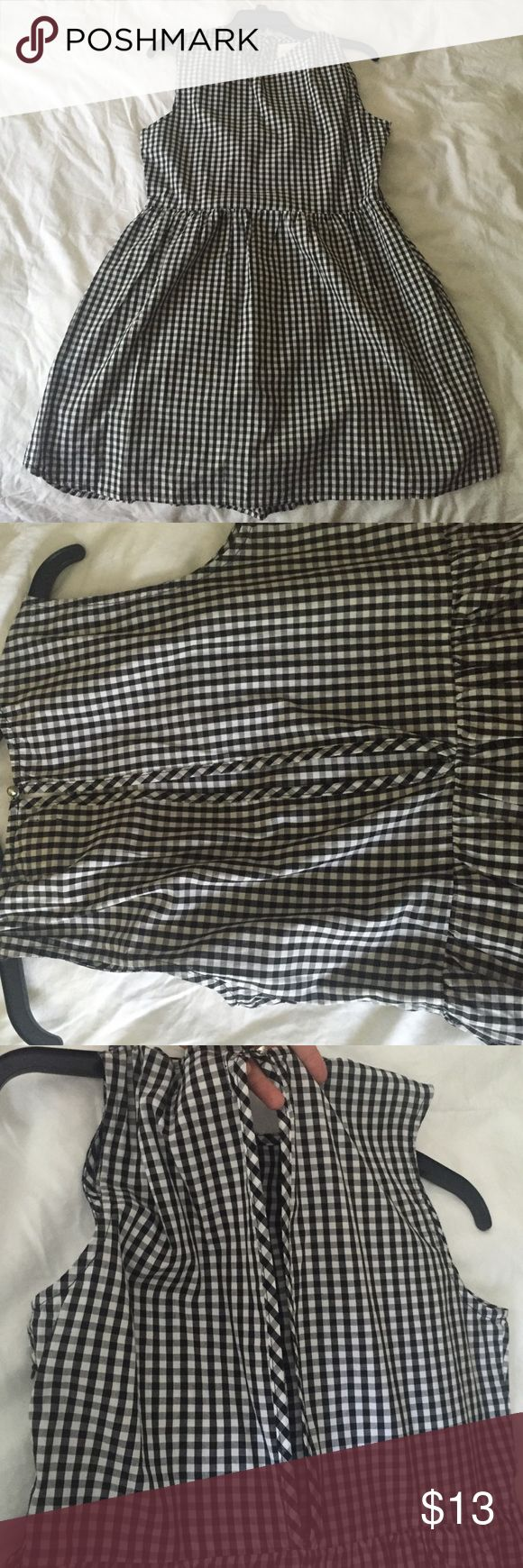 A cute black gingham dress! It's a black and white gingham dress. It has never been worn. The back has a small cuttout!  it's super cute but is a little short! Dresses Mini