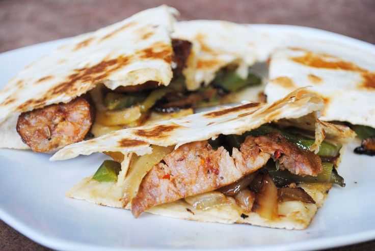 SPORK or FOON -Still exploring this blog, but what I've seen already..I like! I want to try these Sausage and Pepper Quesadillas.