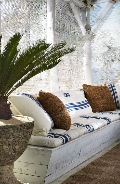 p-lanet-e-arth: Ralph Lauren Home creates a shady beach retreat with bench cushions and throw pillows sewn from classic blue and white striped textiles.