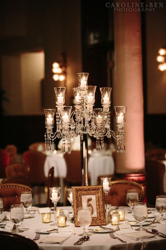 Beautiful tall crystal candelabras surrounded by votives.