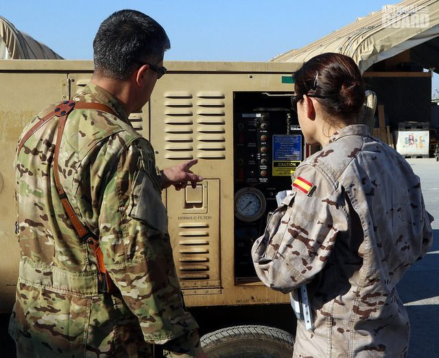NC NationalGuard Maj. Varjian shows a #Soldier assigned to the #Spanish Army the specifications of an auxiliary power unit.