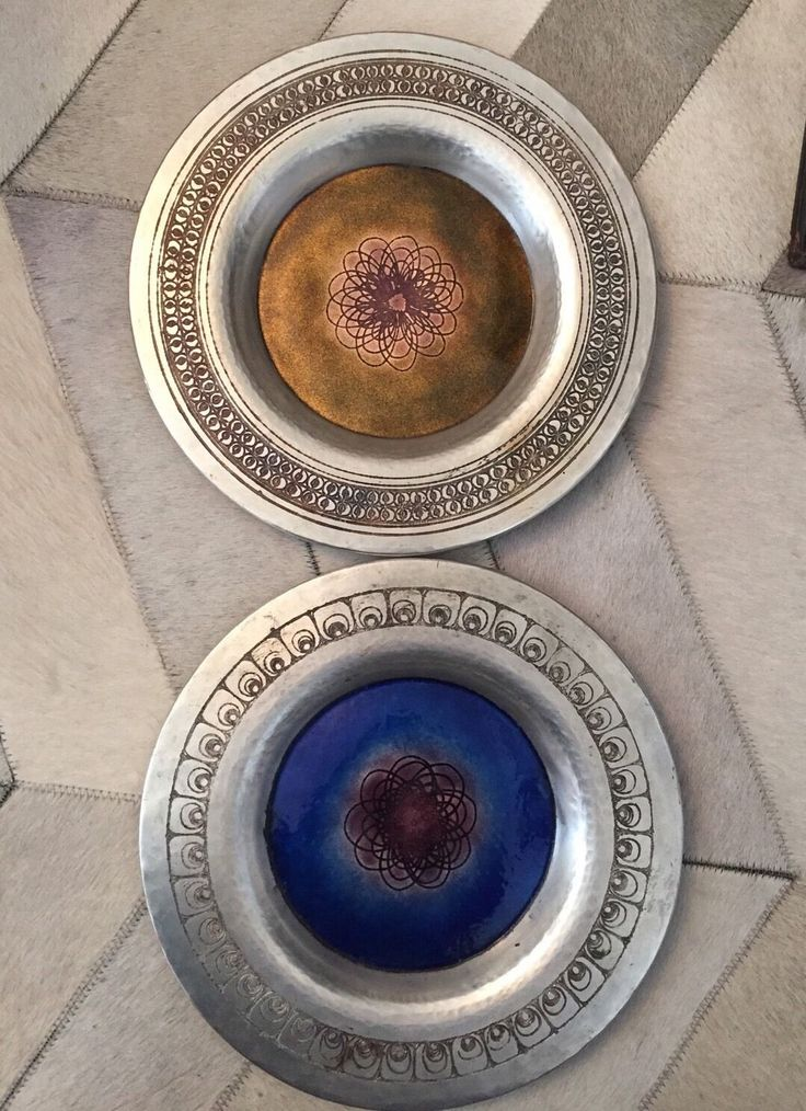 """A recent acquisition.... Love the simplicity of these late, and scarce, '60's Italian enamel & silver plated copper plates by Gallinaro Oggettistica (est.1962-1970's) by Celeste Gallinaro. I've only ever seen 7 ¼"""" diameter ones. These are 10 ½"""" in diameter.  The circular motif on the edge of the blue plate is very reminiscent of the Charles Rennie MacIntosh rose."""
