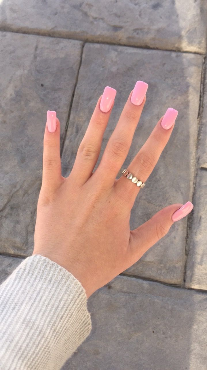 Pink OPI long square acrylic nails.