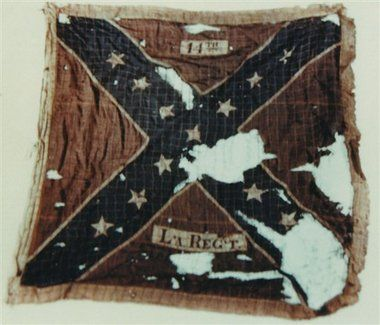 """Battle Flag of the14th Louisiana was issued to the unit in the spring of 1862. This was the first """"battle flag"""" carried by the regiment. It saw action at Gaines Mill on June 27, 1862. Two color bearers were killed while carrying it. The flag remained in service until the color bearer, Frederick Sontag, was captured with the flag at Gettysburg. Rather than surrender the flag, he concealed it under his clothing. He kept his secret until released from prison and returned to the Regt with the…"""