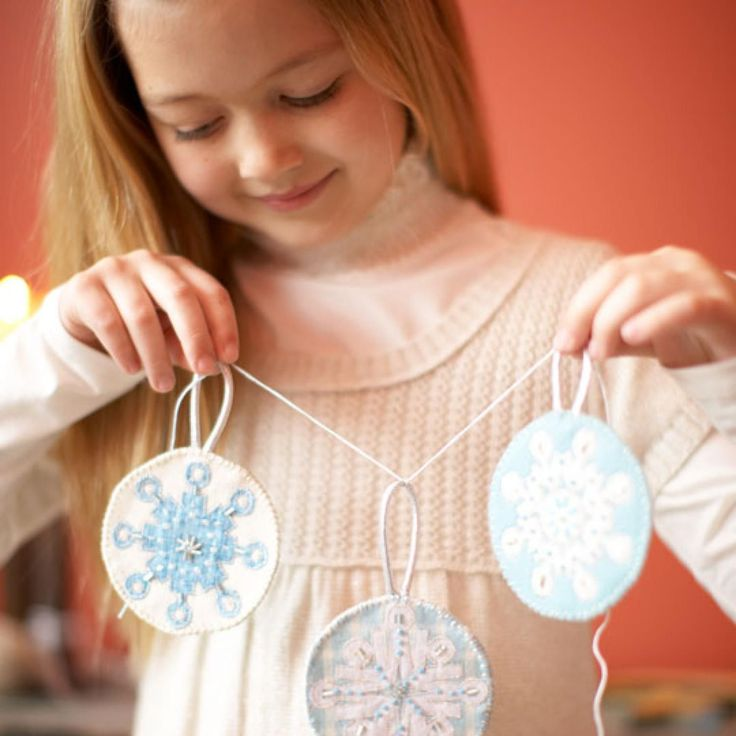 Dress up snowflake ornaments with frosty beads and metallic embroidery