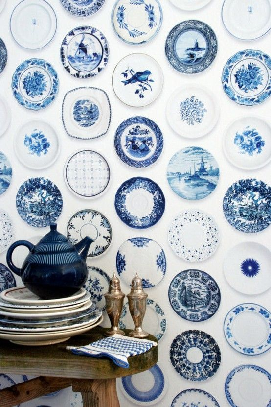 blue & white china on the wall. how in the world do they hang these? OK...maybe it's wallpaper?!! LOL on me!