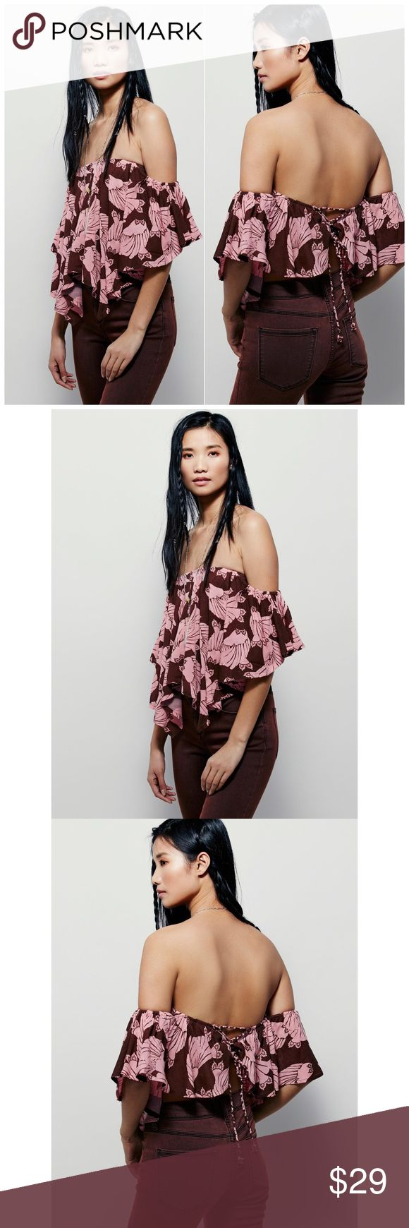 FREE PEOPLE MERPATI PRINT OVER THE SHOULDER TOP Merpati Print Over-the-Shoulder Top Retail $78   New Free People Merpati Print Over-the-Shoulder Top  Retail $78 … Pink Combo  Floaty and romantic, printed off-the-shoulder top in a gauzy cropped silhouette with an open lace-up back and built-in bandeau bra.   Free People   100% Rayon  Hand Wash Cold  Made in Bali    Price tag removed and label marked to prevent retail store return. Free People Tops Blouses