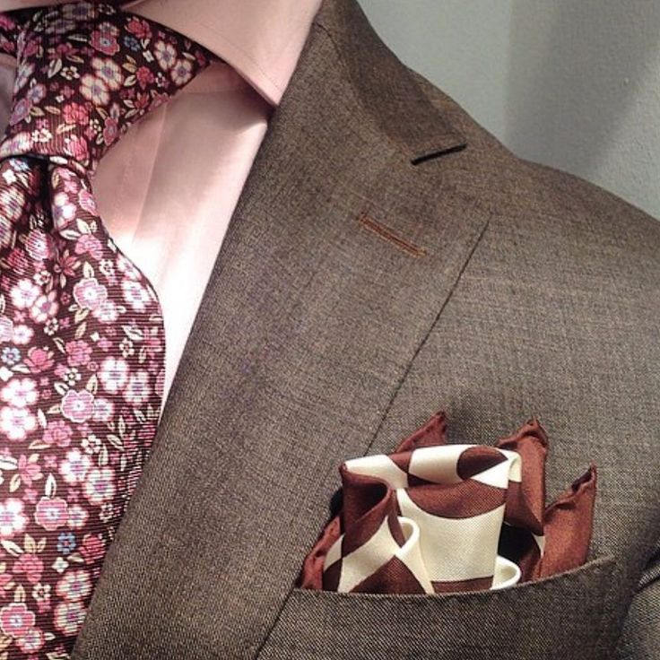 Brown suit / pink floral tie/ brown and white pocket square