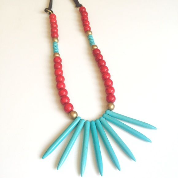 Turquoise spike Necklace Turquoise Howlite spike beads strung with red beads on suede cord, measures 30inches long Immeasurably More Jewelry Necklaces