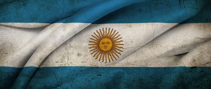 Argentina's flag. Its white, blue and has a sun in the middle.The history of Argentina's flag is wrapped in a curious mix of revolutionary fighting for independence from Spain and Incan sun worship.