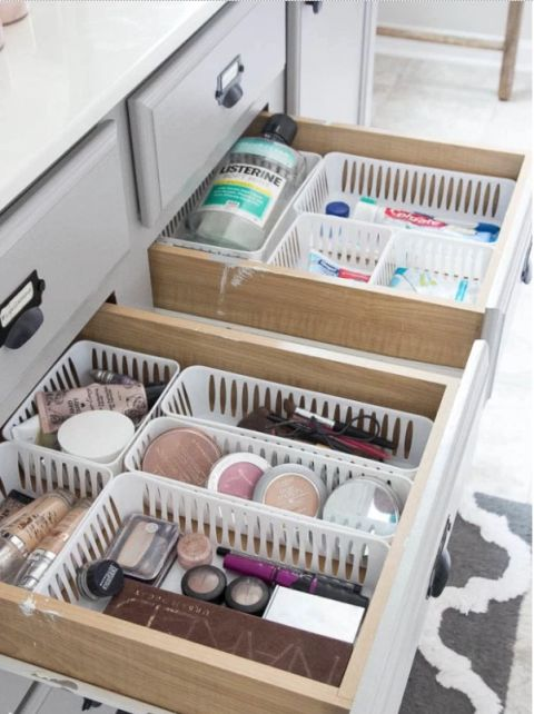 Stuff the drawers in your bathroom full of those small plastic organizers to create order in one of your most chaotic spots. Suddenly makeup doesn't have to fight for space with your toothpaste. See more from The Summery Umbrella »