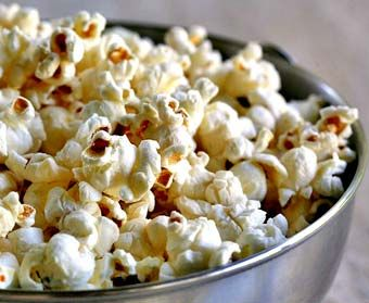 How to make a perfect batch of popcorn, with no burnt kernels.  Easy popcorn recipe.  My kids and I love popcorn - we use coconut oil and nutritional yeast.