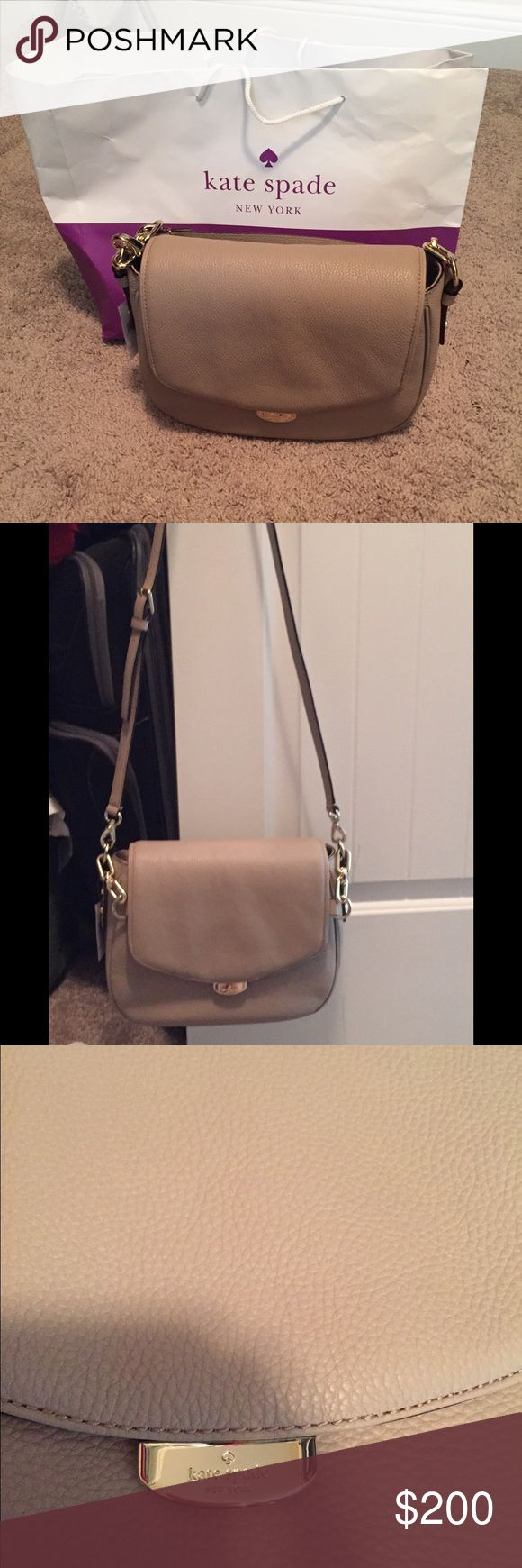 Kate spade cross body This purse is tan in color and with gold hard ware a big crossbody and can also be use as hand bag.. Brand new with tag kate spade Bags Crossbody Bags