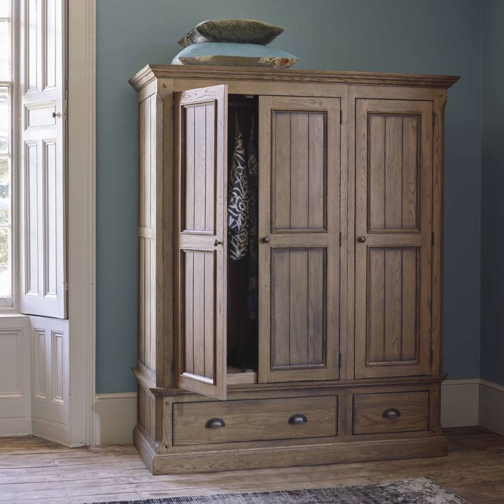 A Generous Triple Wardrobe In Solid Oak With A Traditional Look. Manor  Houseu0027s Darker Stained Finish And Time Honoured Style Work Well In This  Large Scale ...