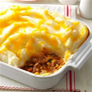 Spicy Shepherd's Pie Recipe -Taco seasoning adds zip to this hearty main dish. It's easy to top with instant mashed potatoes, which I stir up while browning the beef.—Mary Malchow, Neenah, Wisconsin