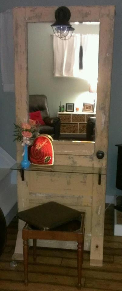 My wife's Valentine's Day gift. A vanity made from an up-cycled door, a mirror we had in the house, and a cheap light fixture wired to the door knob - turning the knob clockwise operates the light.