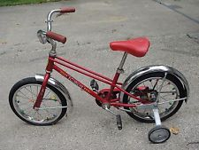 "This looks very similar to my Schwinn Pixie that my grandfather bought me in the late 1960's, with the exception that mine was a girls bike. I was so proud when I got to take the training wheels off!   (red schwinn pixie childrens kids bicycle 16"" vintage original training wheels)."