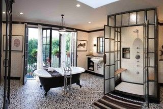 May be my favorite bathroom ever.  Patina metal, patterned tile floor, tub by a window, black, white, and brown...