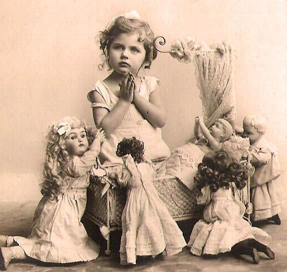 Vintage photo of little girl with her dolls.