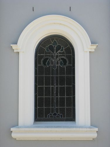 A Stained Glass Window of St Laurence's Catholic Church – Corner Ogilvy and Brumley Streets, Leongatha, Victoria in Spanish Mission style