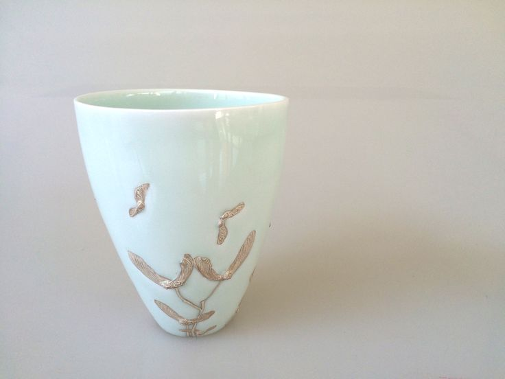 Huey Min Teo.  Maple seeds motif cup, slip cast, Porcelain fired to Cone 10 in reduction atmosphere and Silver lustre, 9x9x11Hcm, 2015 . $80/SOLD OUT