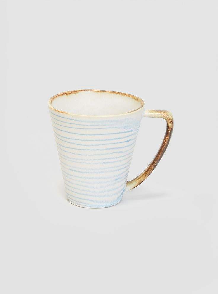 Stripe Mug by Da Terra. Handmade and decorated high-fired stoneware mug with blue striped design from Portuguese brand, Da Terra. - Please note, each piece is individually handmade and may vary slightly from the image. - High-fired stoneware. - Hand-painted. - Made in Portugal.