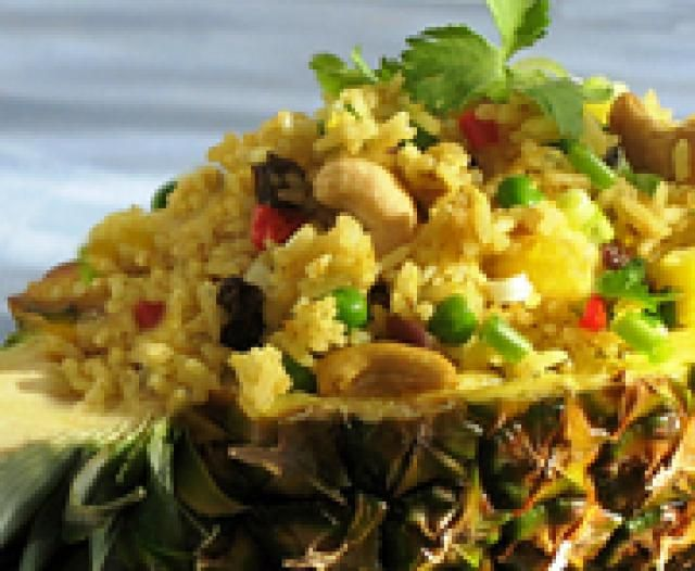 Thai Curry Fried Rice with Pineapple (Easy!): Beautiful Thai Curry Fried Rice (served here in a carved-out pineapple!)