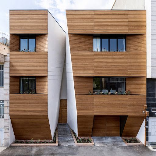 Afsharian's House by ReNa Design has a huge vertical slice in its facade