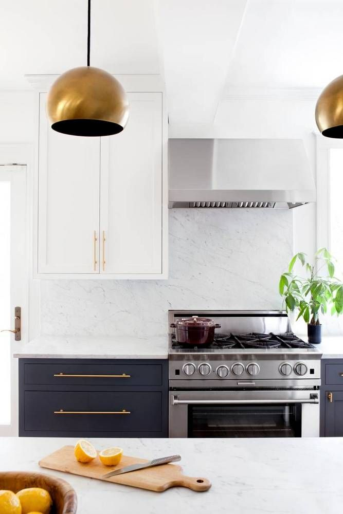 See more images from brass, marble, and other current-day classics in a remodeled kitchen! on domino.com