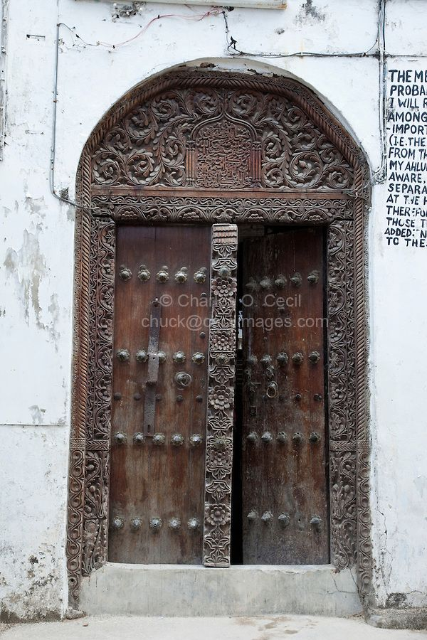 Stone Town, Zanzibar, Tanzania. Mosque Entrance, Indian-style Door. Arabic Calligraphy above the door. COPYRIGHT:© Charles O. Cecil