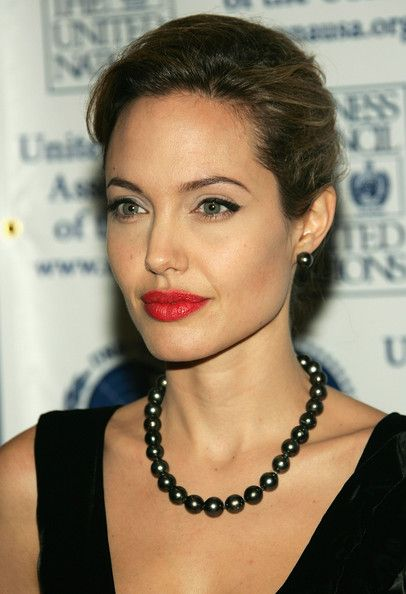 Angelina Jolie shows her darker side with these black pearls. The combination of her necklace with red lipstick is absolutely stunning. Is there any look she CAN'T pull off?