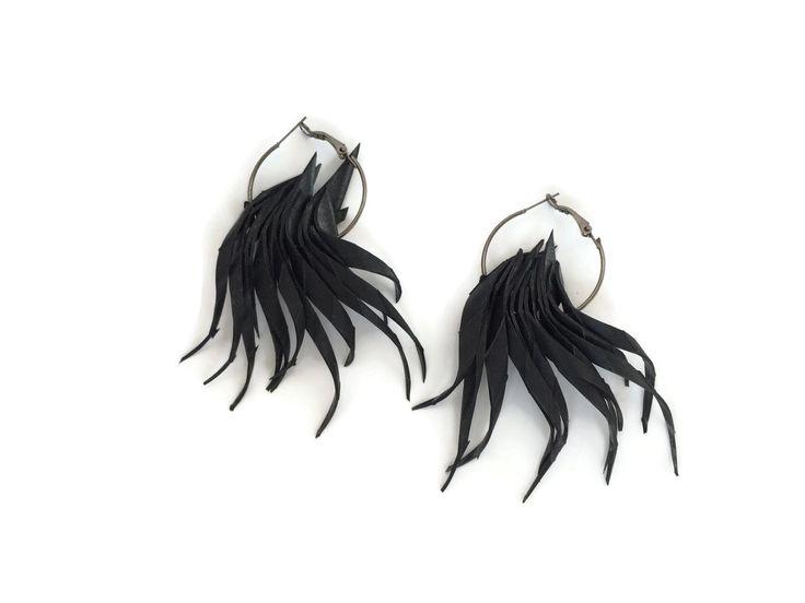 Upcycled inner tube octopus earrings by Laura Zabo