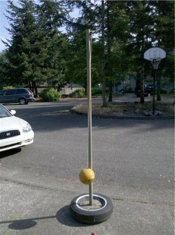 volleyball or tetherball pole made out of old tires and a bag of cement...nothing fancy shmancy for Catholic schools with no playground budget!!! And they worked GREAT!