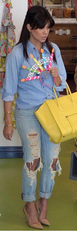 Kourtney Kardashian: Bracelet – Cartier  Shoes – Manolo Blahnik  Purse – Celine  Shirt – Sam & Lavi