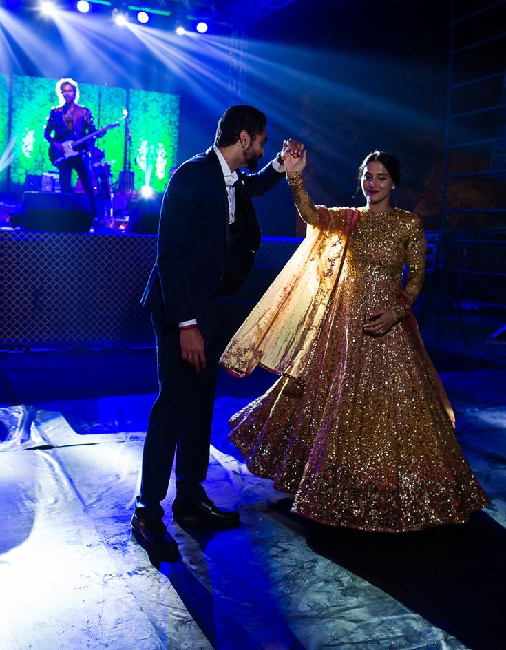 A Floor length Anarkali with complete Gold sequence by Sabyasachi for the Welcome Dinner of Tarisha of WeddingSutra.