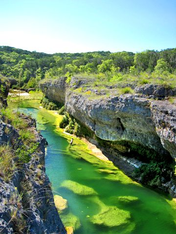 The narrows on the Blanco River, Texas Hill Country.  The river cuts through an exposed coral reef dating from the Late Cretaceous period.