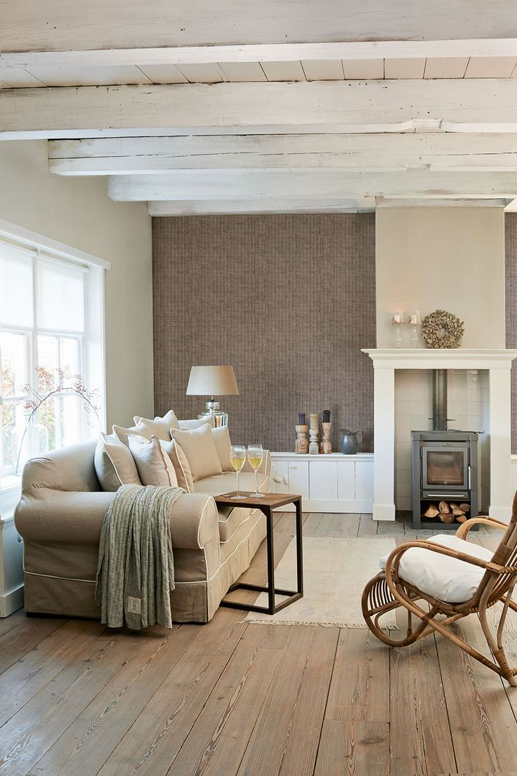 This beautiful wicker design wallpaper teams perfectly with the cosy log burner, wooden floors and neutral furnishings. Create an inviting and comfy space to relax on your own or with friends and family! Pattern 18334.
