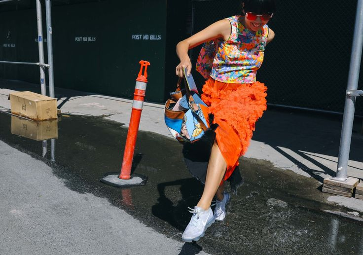 Susie Bubble in an Eckhaus Latta top, Molly Goddard skirt, and Nike shoes with a Loewe bag