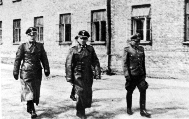 Auschwitz-Birkenau, Poland, Senior SS officers visiting the camp, 1941. Evil men looking at the evil they are doing and thinking of the 6000 they murder every day can be increased
