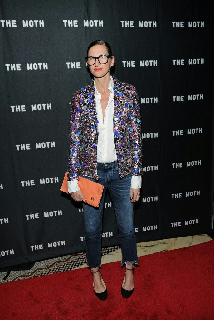 Jenna Lyons holiday party outfit - white blouse, step hem jeans, sequin blazer, and ankle strap heels
