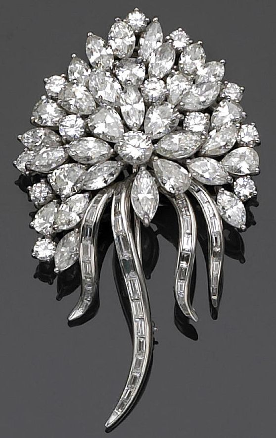 A diamond brooch-pendant  designed as a bouquet of round brilliant, marquise, pear and baguette-cut diamonds; estimated total diamond weight: 18.00 carats; mounted in platinum.